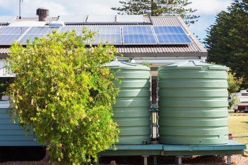 off grid solar system on roof of house on property near cairns