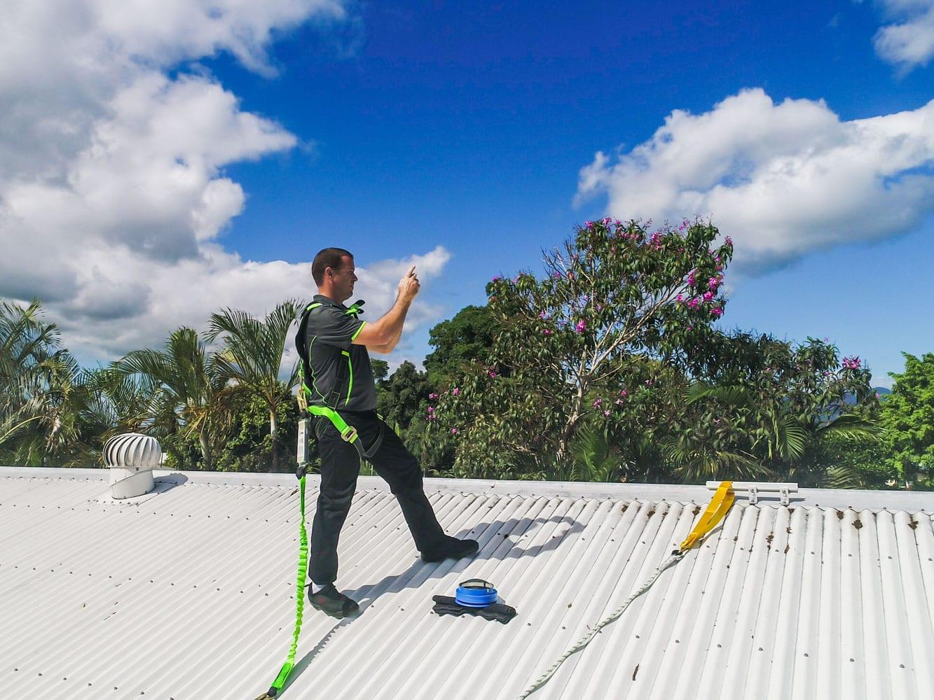 Solar Systems Cairns - Elliot fox checks surrounding trees